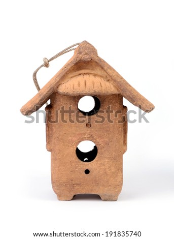 Front view of clay birdhouse on white background. - stock photo
