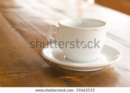 front view of coffee cup on wooden table - stock photo