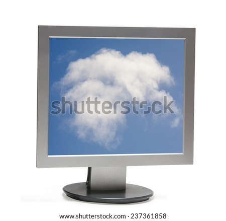 Front view of computer monitor isolated with clipping path - white clouds on background blue sky - stock photo