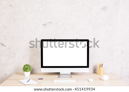 Front view of creative hipster desktop with blank white computer screen, coffee cup, smart phone and other items on concrete background. Mock up - stock photo