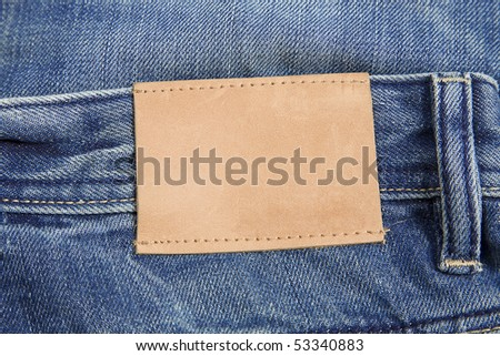 front view of denim label, blue jeans and leather label