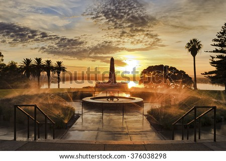 front view of fallen soldiers memorial in Kings park of Perth , capital of Western Australia. Rising sun litting fountains and obelisk - stock photo