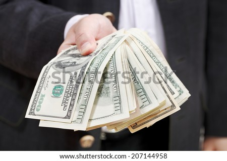 front view of fanned dollar banknotes in male hands isolated on white background - stock photo