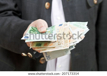 front view of fanned euro banknotes in bisnessman hands isolated on white background - stock photo