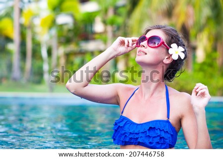 front view of fit woman in sunglasses in luxury spa pool - stock photo
