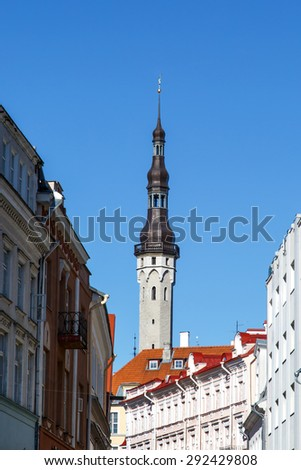 Front view of medieval Lutheran Church of the Holy Ghost in Tallinn, Estonia, on blue clear sky background. - stock photo