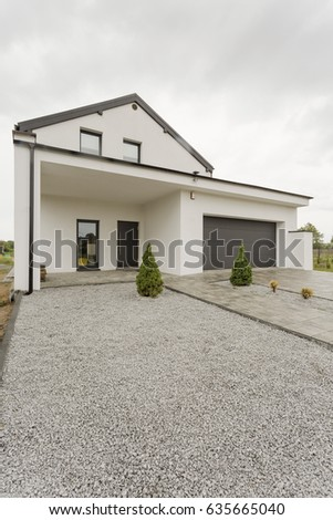 Delightful Front View Of Modern White House Exterior And Gravel Driveway