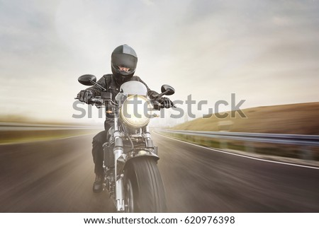 Front view of motorcycle driver driving