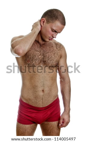 Front view of muscular man with neck pain. Isolated on white.
