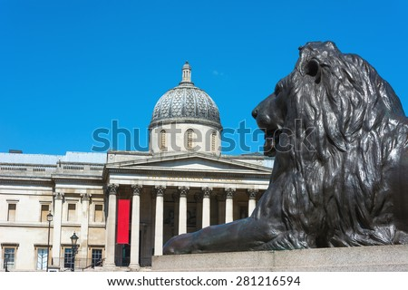 Front view of National Gallery London with bronze lion in the foreground. - stock photo