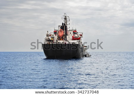 Front view of oil and petroleum tanker ship in the sea - stock photo