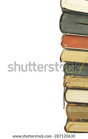 Front view of old books stacked on a shelf. Books without title and author. Isolated on white background, place for your text. - stock photo