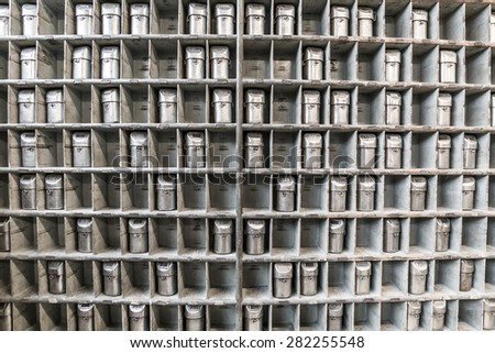 Front view of old mine masks in pigeonholes - stock photo