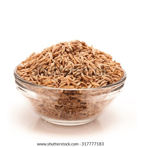 Front view of Organic Cumin seed (Cuminum cyminum) in glass bowl isolated on white background.