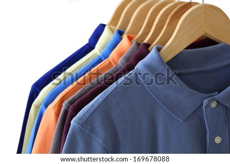 Front view of polo shirts on hanger isolated over white background - stock photo