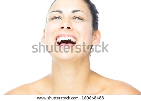 Front view of pretty woman laughing on white background - stock photo