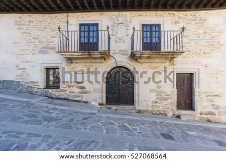 Front view of Puebla de Sanabria stone house facade, Spain