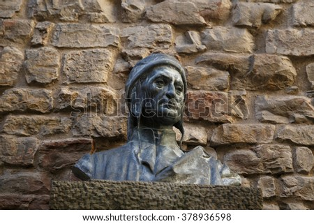 Front view of sculpture monument of famous italian poet Dante Alighieri, in front of Dante House in Florence. - stock photo