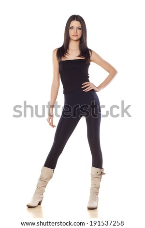 front view of skinny young girl in tights - stock photo