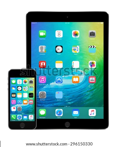 Front view of space gray Apple iPad Air 2 and iPhone 5s with announced on WWDC 2015 iOS 9 on the displays, designed by Apple Inc. Isolated on white background. Varna, Bulgaria - February 02, 2015. - stock photo