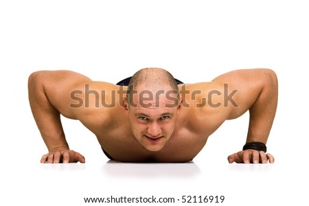 Front view of strong, handsome man doing push-ups as bodybuilding exercise, training his muscles. Isolated on white. - stock photo