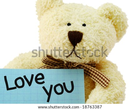 "Front view of teddy bear toy with ""Love you"" note, isolated on white background"