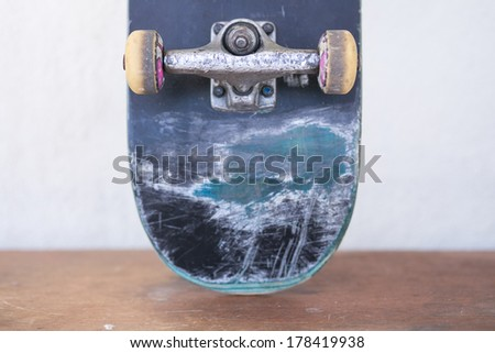 Front view of the back of a skate board with yellow wheels - stock photo