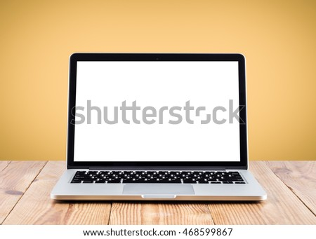Front view of the laptop is on the work table, colorful background, clipping path inside