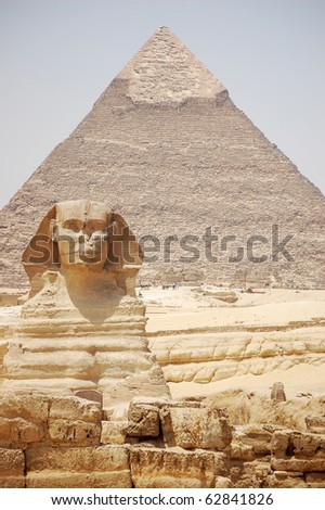 Front view of the Sphinx & Khafre's Pyramid in the background. - stock photo