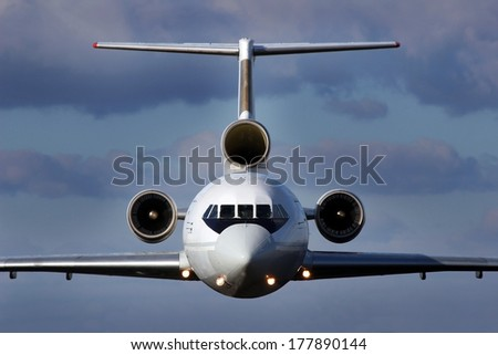 Front view of the three-engine aircraft in flight - stock photo
