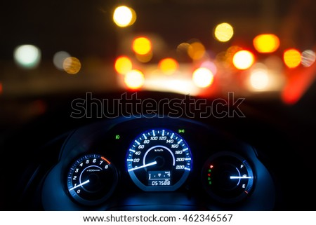 front view of traffic jam and driving at night - lights car blurry - dial-mile car