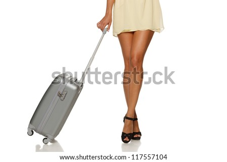 Front view of woman legs with a suitcase on the white background - stock photo