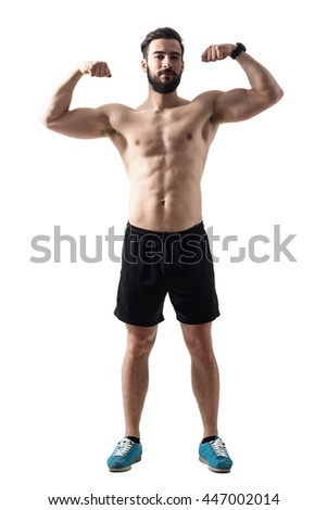 Front view of young bearded fit athlete flexing muscles. Full body length portrait isolated over white studio background. - stock photo