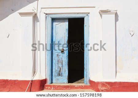 Front view on the blue ancient door. - stock photo