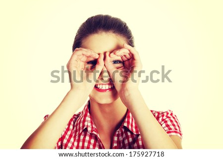 Front view portrait of a young joyful female caucasian teen making a face to the camera - stock photo
