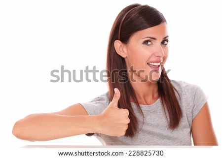 Front view portrait of cute female with ok sign looking at you on isolated white background - stock photo