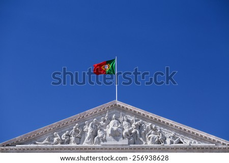 Front view tympanum of the pediment on the Portuguese Parliament building, Sao Bento Palace, the capital and the largest city of Portugal - stock photo