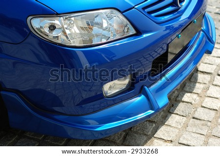 Front view with detail of a spotive car - stock photo