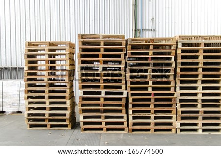 Front view wooden pallets in warehouse - stock photo