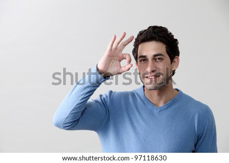 front vview of man holding ok sign - stock photo