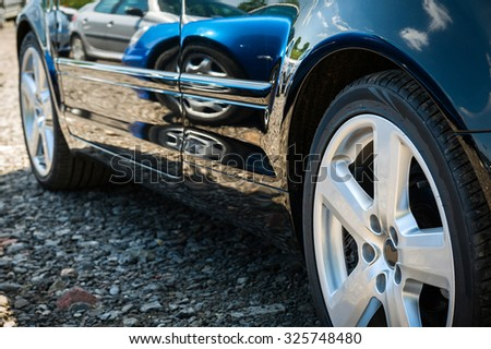 Front wheel details. Side view of the modern car. - stock photo
