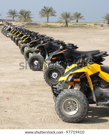 Front wheel of desert scooter arranged in a row - stock photo