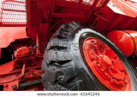 Front wheel of vintage giant mining truck. - stock photo