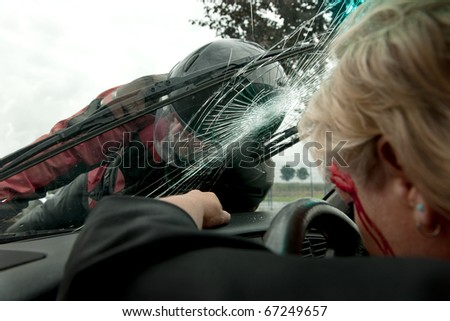 Frontal hit between a car and motorcycle as viewed from inside the car - stock photo