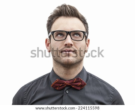 Frontal portrait of a young man with glasses looking up left, isolated against a white background. - stock photo