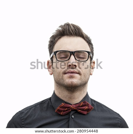 Frontal portrait of a young man with glasses with his eye closed, isolated against a white background. - stock photo