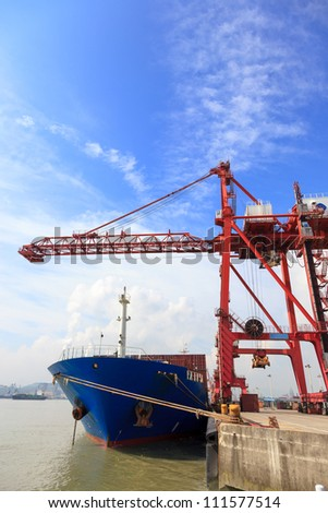 Frontal view of a container ship with a  gantry cranes loading cargo containers,Mawei harbor,Fuzhou,China - stock photo