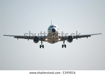 frontal view of a landing airplane