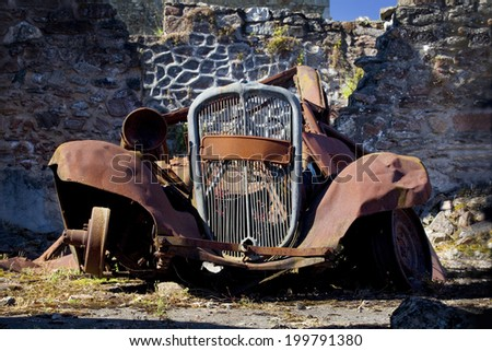 Frontal view of a rusty old car. Rusty old car - stock photo