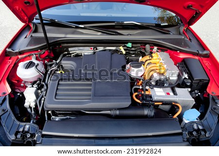 Frontal view of the two engines of a modern hybrid car.  Hybrid car engine.